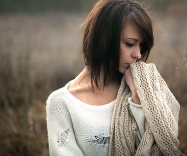 sad-brunette-woman-outside-alone